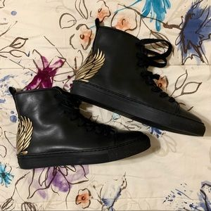 Katy Perry Black and Gold Winged High Tops